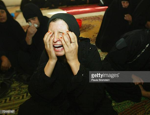 Relatives mourn the deaths of three family members Shaimaa Hameed Abbas her baby Adhraa 5 months and Dunya Hameed Abbas age 15 October 28 2003 in...