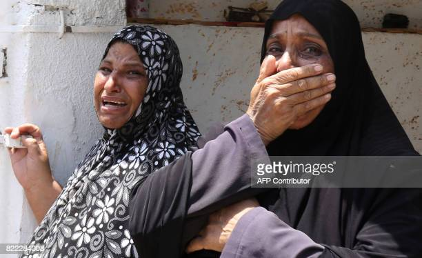 Relatives of 17yearold Mohammed Jawawdeh who was killed on the weekend when he attacked a security guard at the Israeli embassy compound in the...