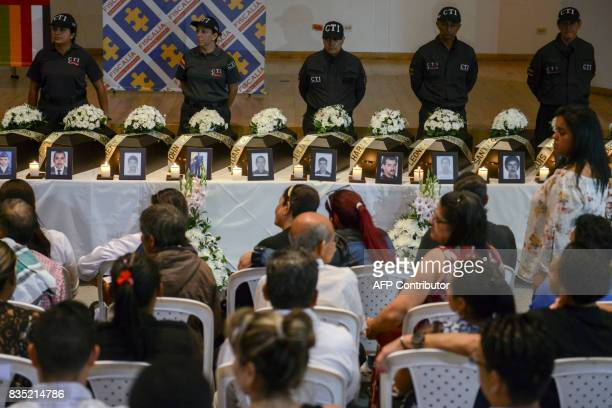 Relatives of 21 victims of the Colombian civil war attend a ceremony in which they wake the remains of their loved ones recently found in different...