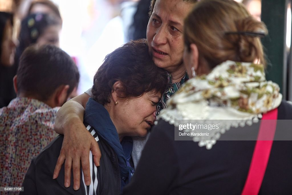 Relatives of 27-year-old flight officer Gulsen Bahadir, a victim of yesterdays attack on Istanbul Ataturk airport, mourn at her Turkish flag-draped coffin during her funeral ceremony in Istanbul, June 29, 2016, Turkey. Three suicide bombers opened fire before blowing themselves up at the entrance to the main international airport in Istanbul yesterday. The Istanbul Governor's Office says 41 people have been killed, 37 of the victims have been identified, including 10 foreign nationals and three people with dual citizenship. More than 230 people were wounded but 109 have been discharged from hospitals in the deadly suicide bombing attack in Istanbul's Ataturk airport blamed on the Islamic State group.