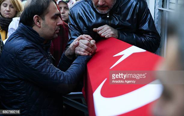 Relatives of 35yearsold security guard Fatih Cakmak mourn over the coffin during his funeral prayer service on January 02 2017 at Yavuz Selim Mosque...