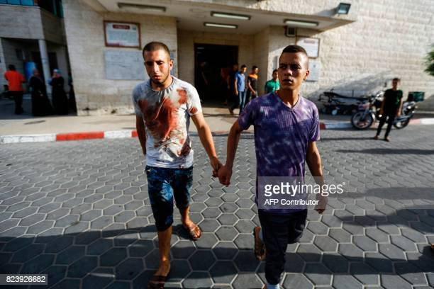 Relatives of a 16yearold Palestinian who was reportedly killed in clashes with the Israeli army along the Gaza border leave the hospital where his...