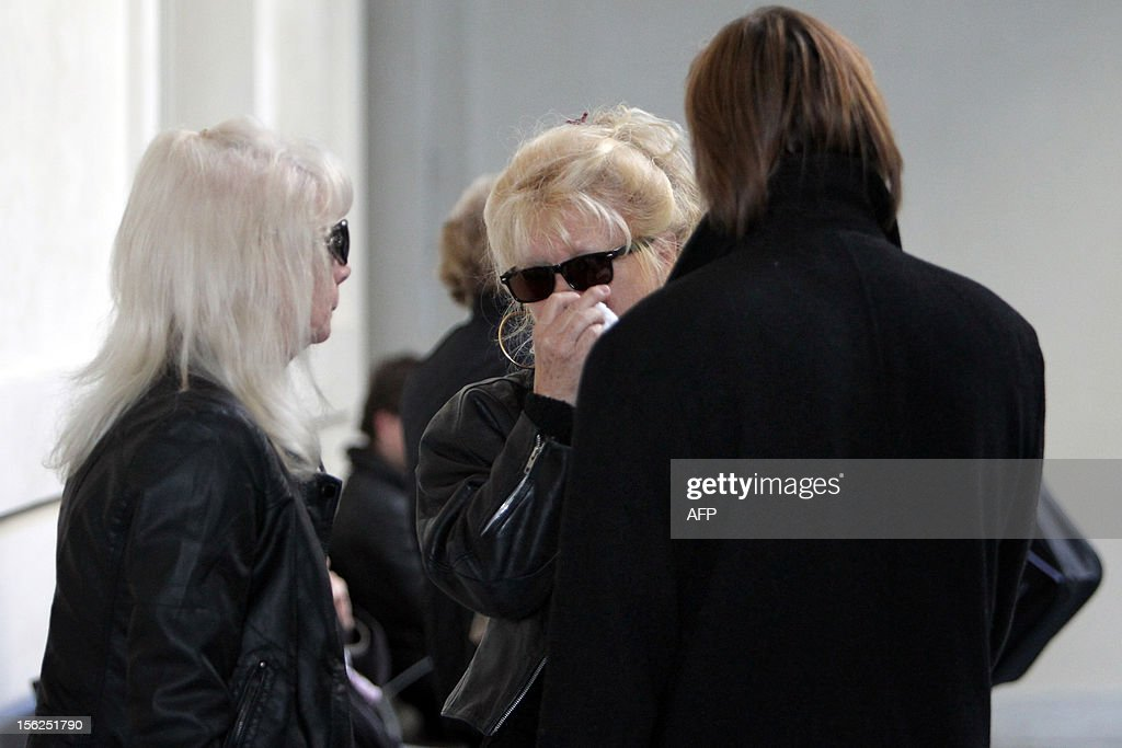 Relatives of a 19-year-old boy wait for the start of his trial for shooting dead his parents and 10-year-old twin brothers in 2009, on November 12, 2012 in a courtroom in Ajaccio. The accused, named as Andy, exterminated the entire family in August 2009 with his father's Winchester rifle in an act he said occurred in a trance-like state.