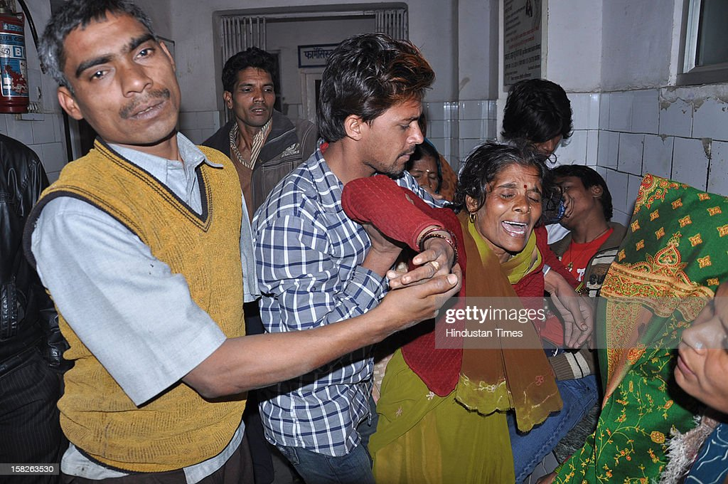 Relatives of a 38 year old man who jumped off from a water-tank at Vijay Nagar as police and locals looked on, Victim was later declared dead on December 12, 2012 in Ghaziabad, India.