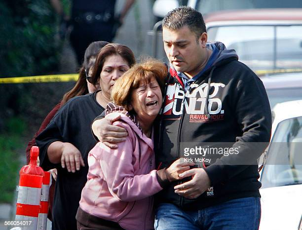 Relatives of a fatal shooting near teh corner of 2100 black of Echo Park and Baxter St react to the news that the victim has died Saturday December...