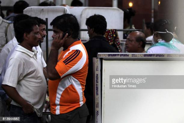 Relatives of a patient admitted at KEM Hospital Parel speak on phone as bomb blasted at Kabutarkhana Dadar on Wednesday