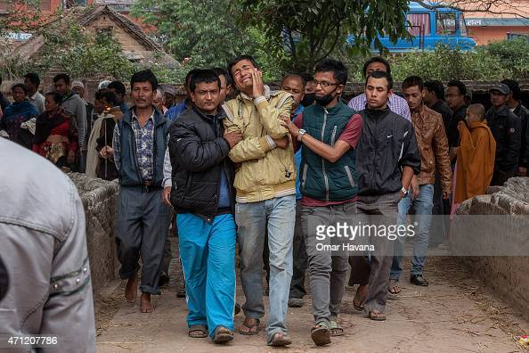 Relatives of a victim of the earthquake that hit Nepal yesterday cry while walking to the cremation site on April 26 2015 in Bhaktapur Nepal A major...