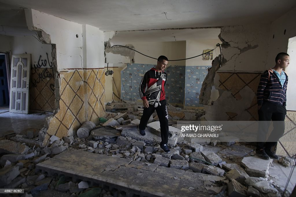 Relatives of Abdelrahman Shaludi a Palestinian who killed two Israelis with his car last month walk at his family home after it was razed by Israeli...