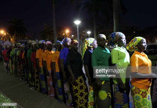 Relatives of abducted girls line up to meet with President of Nigeria Muhammadu Buhari after the releasing 82 of school girls kidnapped by Boko Haram...