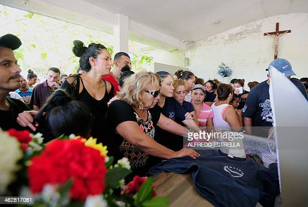 Relatives of Alberto Flores a member of the SelfProtection Police mourn during his funeral at the cementery of Buenavista Tomatla in Michoacan State...