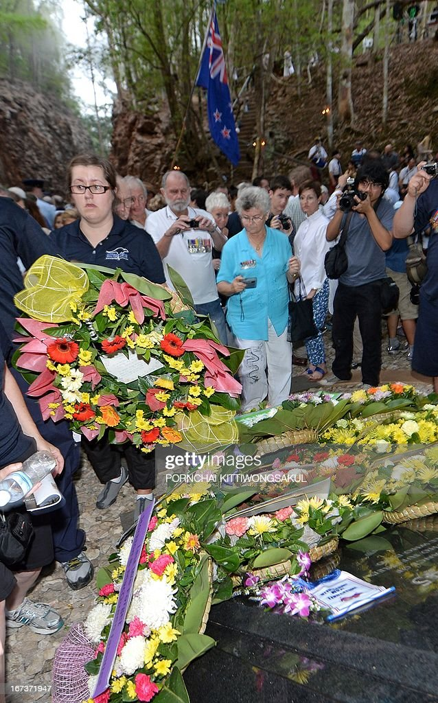 Relatives of Australian war veterans lay a wreath during a ceremony to mark Anzac Day at Hellfire Pass in Kanchanaburi province, western Thailand on April 25, 2013. Hundreds of Australian and New Zealand war veterans and relatives of fallen soldiers marked Anzac Day with a dawn vigil along Thailand's infamous Death Railway, where over 110,000 people perished during WWII.