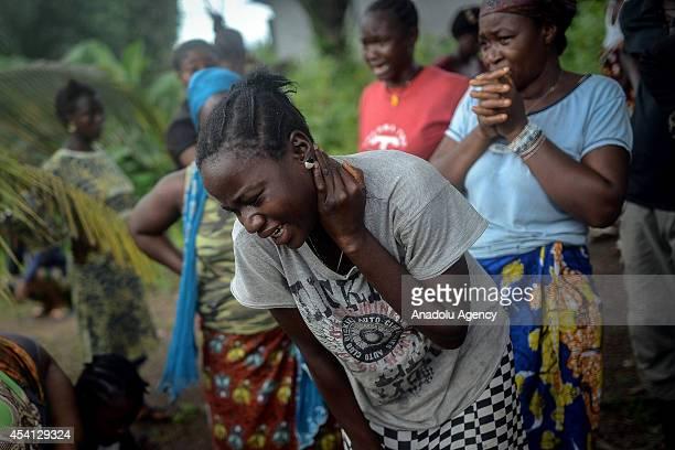 Relatives of Baindu Koruma died due to the Ebola virus mourn in Lango village Kenema Sierra Leone on August 25 2014 Ebola a contagious disease for...
