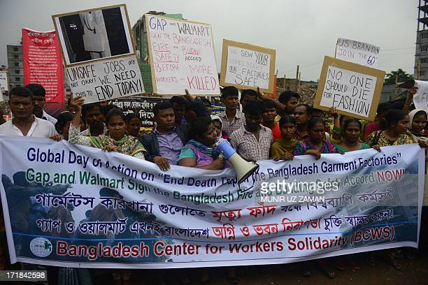Relatives of Bangladeshi workers who lost their lives in a garment factory disaster shout slogans as they gather with banners and placards in Savar...