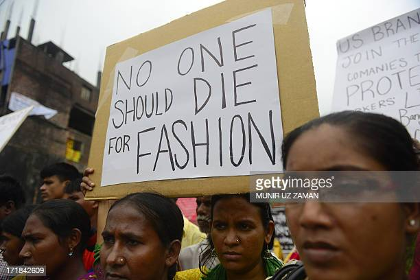 Relatives of Bangladeshi workers who lost their lives in a garment factory disaster gather with banners and placards in Savar on the outskirts of...