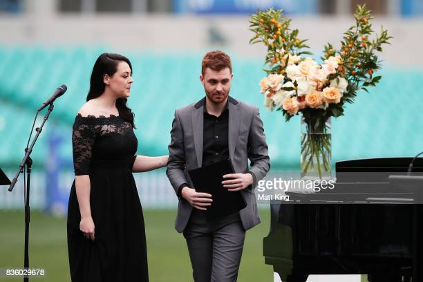 Relatives of Betty Cuthbert Caroline Mulvenna and Josh Willard perform during a State Memorial service for Betty Cuthbert at Sydney Cricket Ground on...