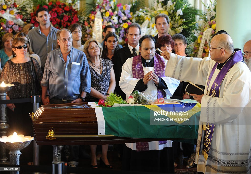Relatives of Brazilian architect Oscar Niemeyer attend his funeral at the City Palace in Rio de Janeiro, Brazil, on December 7, 2012. Niemeyer, the Brazilian icon who revolutionized modern architecture and designed much of the country's futuristic capital Brasilia, died in Rio de Janeiro Wednesday at 104.