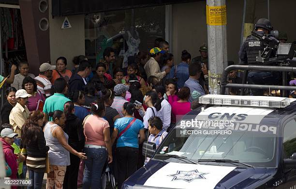 Relatives of children await outside the shelter 'La Gran Familia' where a police raid on the eve rescued 596 people including 458 children in Zamora...