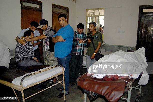 Relatives of deceased Bangladeshi blogger Ananta Bijoy Das react after seeing his body in Sylhet on May 12 2015 A masked gang wielding machetes...