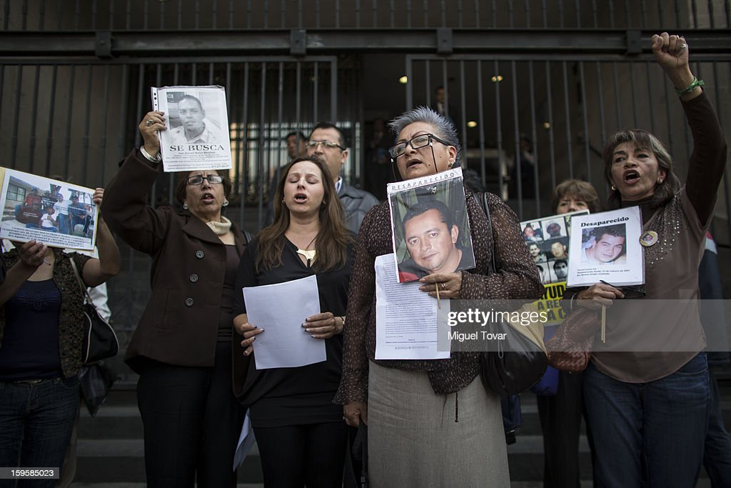 Relatives of disappeared, victims of violence and deaths by the drug war, protest outside the Government Department on January 16, 2013 in Mexico City, Mexico. They are demanding that President Enrique Peña Nieto meets their justice demands.