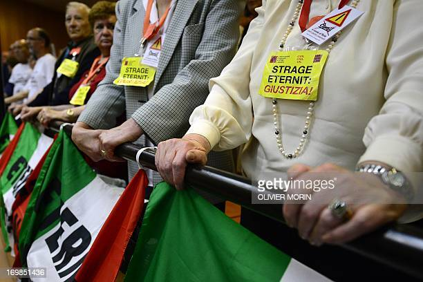 Relatives of employees who died related to asbestos react at the end of the appeal court trial sentence against Swiss billionaire Stephen Schmidheiny...