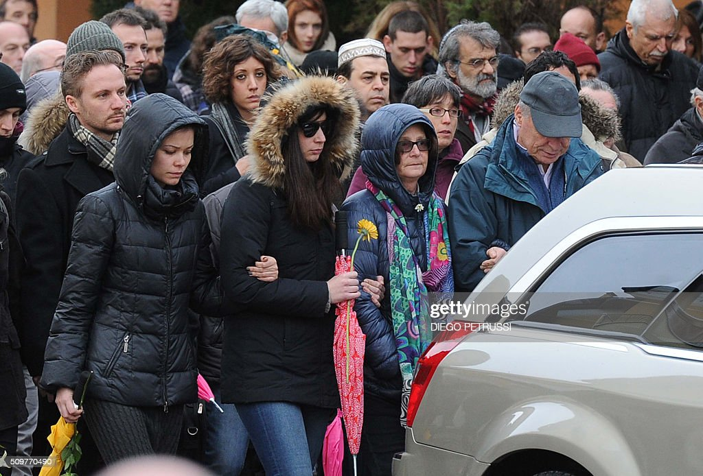 Relatives of Giulio Regeni, a Cambridge University PhD student who was found dead bearing signs of torture after disappearing in Cairo last month, including his father Claudio (R), mother Paola (2nd R) follow the hearse during his funeral in Fiumicello on February 12, 2016. / AFP / diego petrussi