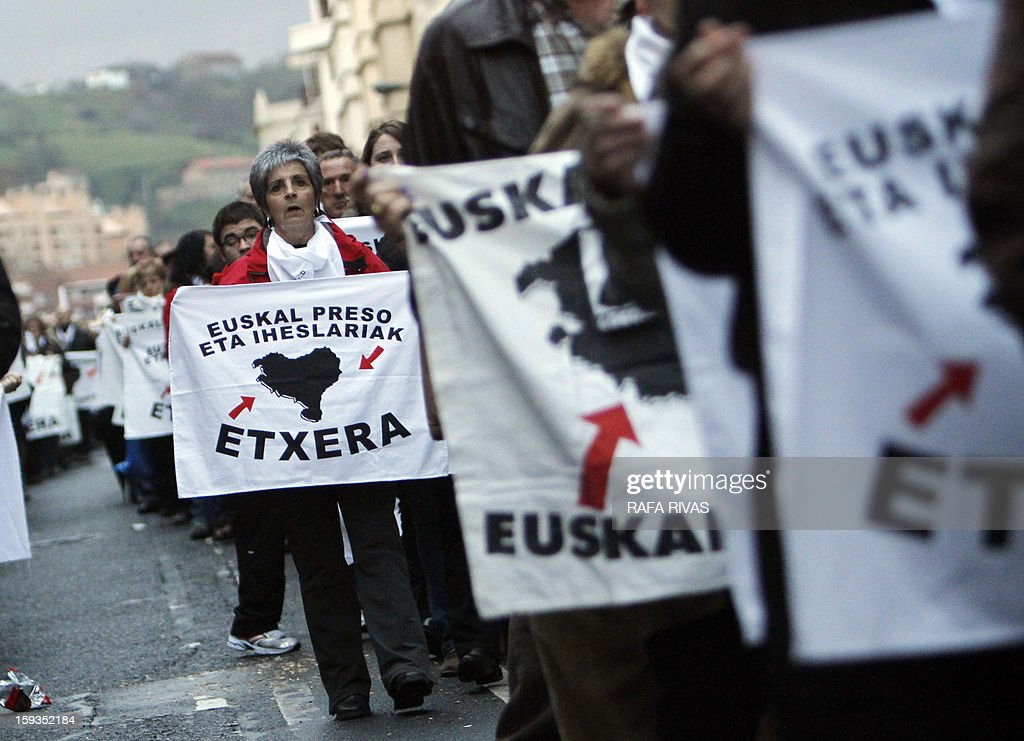 Relatives of imprisoned members of ETA take part in a march demanding the transfer of ETA prisoners to the Basque country during a demonstration called by 'Herrira!' a pro-prisoners group in the Northern Spanish Basque city of Bilbao on January 12, 2013. The placard reads: 'Basque prisoners in the Basque country.'