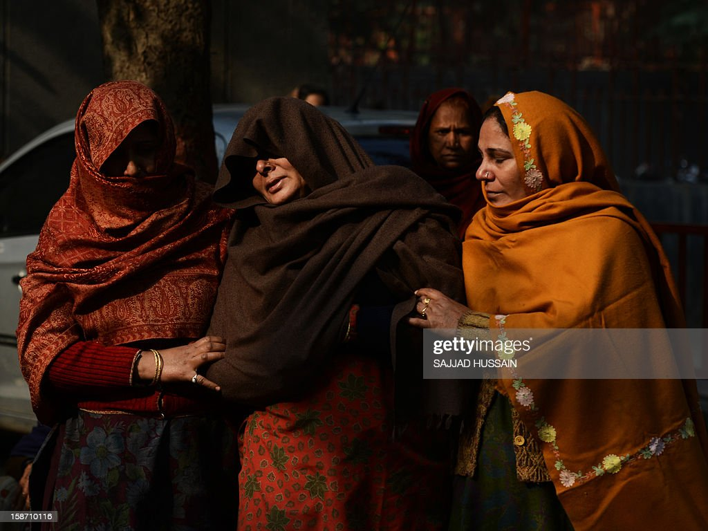 Relatives of Indian policeman Subash Tomar mourn during his funeral in New Delhi on December 25, 2012. Tomar, a 47-year-old constable Indian policeman who was injured in clashes during a protest over a gang-rape in New Delhi has died. Tomar, a 47-year-old constable deployed at the India Gate monument on December 23 to control the protests, was beaten up by a mob and rushed to hospital by the police.