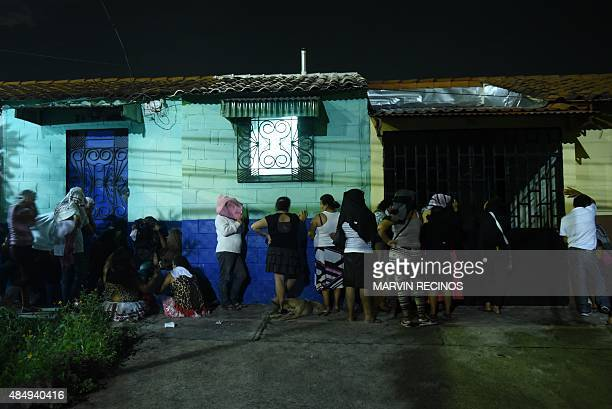 Relatives of inmates await news outside the Quezaltepeque prison where at least 14 inmates were killed when violence erupted between two factions of...