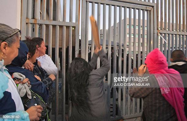 Relatives of inmates demonstrate as they gather outside the Topo Chico prison in the northern city of Monterrey in Mexico where according to local...
