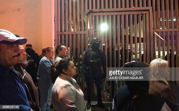 Relatives of inmates gather outside the Topo Chico prison in the northern city of Monterrey in Mexico where according to local media at least 30...
