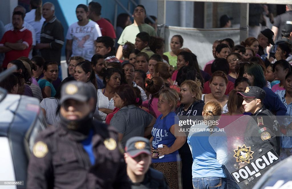Relatives of inmates gather outside the Topo Chico prison -where a riot took place- in Monterrey, Mexico on February 11, 2016. Riot police and ambulances were deployed at the Topo Chico prison as smoke billowed from the facility. At least 49 inmates were killed in a Mexican prison brawl on Thursday, as prisoners fought with bats, sticks and blades and ignited a fire in the overcrowded penitentiary. AFP PHOTO / JULIO CESAR AGUILAR / AFP / Julio Cesar Aguilar