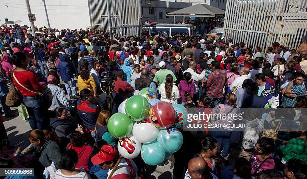 Relatives of inmates gather outside the Topo Chico prison where a riot took place in Monterrey Mexico on February 11 2016 Riot police and ambulances...