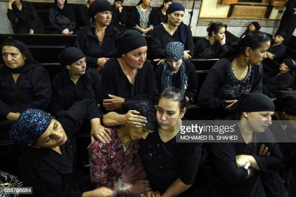 Relatives of killed Coptic Christians grieve during the funeral at Abu Garnous Cathedral in the north Minya town of Maghagha on May 26 2017 Egypt...
