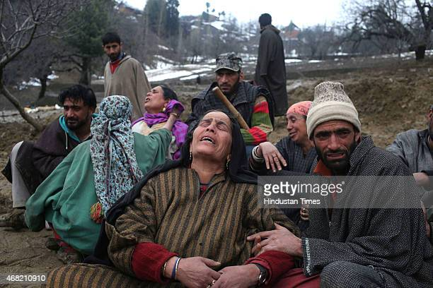 Relatives of landslide victims mourn during a funeral in the village of Laden at Chadoora on March 31 2015 some 40kms west of Srinagar India...