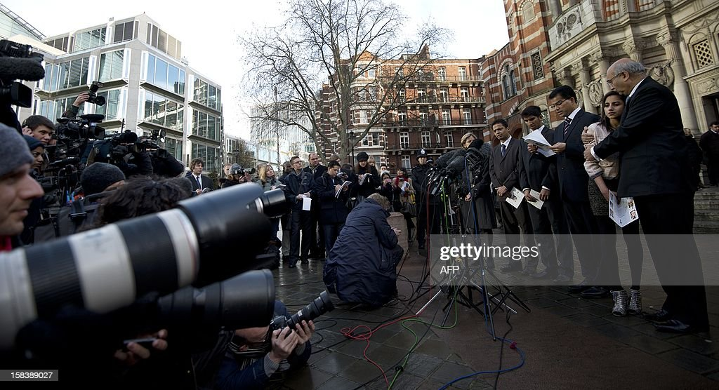 Relatives of late nurse Jacintha Saldanha, gather as husband Benedict Barboza (C) reads a statement whilst MP Keith Vaz comforts daughter Lisha Saldanha (R) as they leave Westminster Cathedral in central London following of a service of Thanksgiving for the life of Jacinda Saldanha on December 15, 2012. Indian-born nurse Jacintha Saldanha, 46, was found hanged a week ago, days after taking a call at King Edward VII's hospital from two Australian radio presenters posing as Queen Elizabeth II and William's father Prince Charles. AFP PHOTO/BEN STANSALL