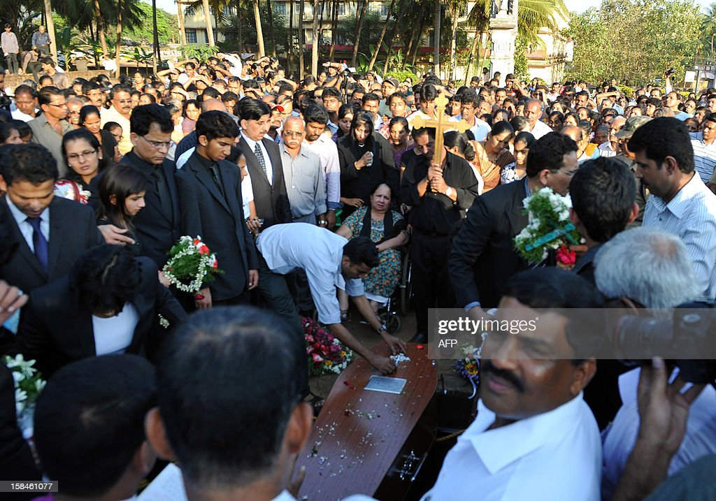 Relatives of late nurse Jacintha Saldanha including daughter Lisha Saldanha (3rd L) and son Junal Saldanha (5th L), with their father Benedict Barbosa (4th L), look on during their mother's funeral at The Shirve Church cemetary near Mangalore on December 17, 2012. About 2,000 mourners have packed a Catholic church in southwest India for the funeral of the nurse who was found hanged after taking a hoax call to the hospital treating Prince William's wife. Indian-born Jacintha Saldanha, 46, apparently committed suicide after answering the telephone call from Australian radio DJs to the hospital where the pregnant Duchess of Cambridge was admitted with acute morning sickness.AFP PHOTO/Manjunath KIRAN