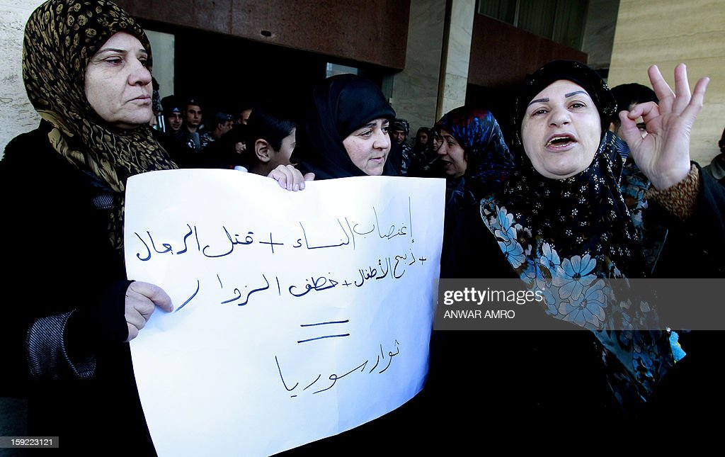 Relatives of Lebanese Shiite pilgrims kidnapped last May in Syria hold a placard and shout slogans during a protest in front of the Qatari embassy in Beirut on January 10, 2013. A group of about 50 demonstrators picketed the embassy of Qatar, which backs Syria's anti-regime rebels. The abductions of 11 Lebanese Shiite pilgrims were claimed by Abu Ibrahim, a strongman in rebel territory in northern Syria that claims affiliation to the main rebel FSA. The placard reads 'rape of women + murder of men + massacre of children + kidnaping of visitors = rebels of Syria'.