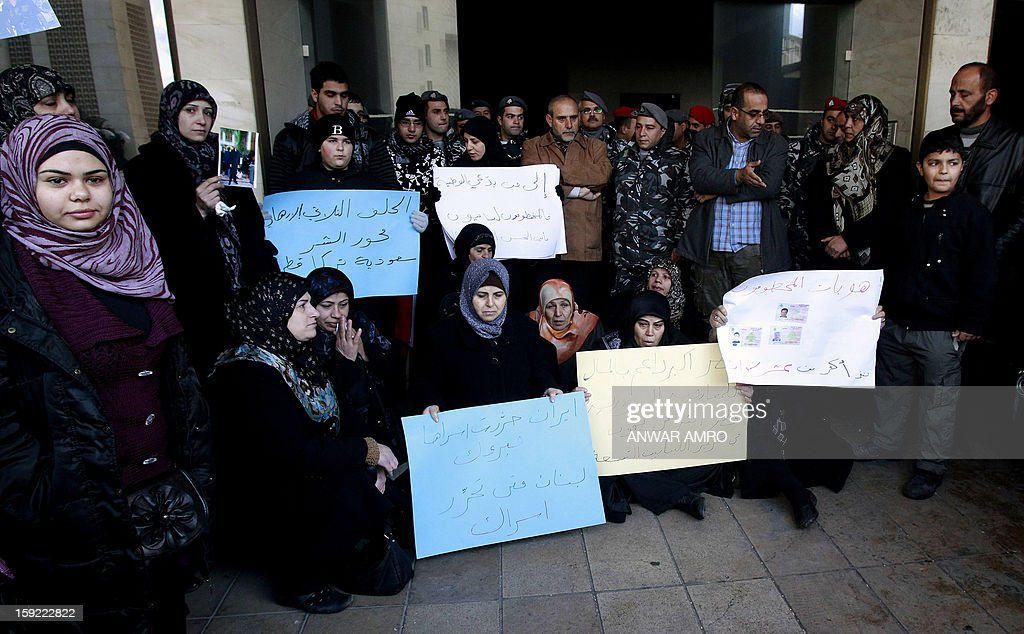 Relatives of Lebanese Shiite pilgrims kidnapped last May in Syria hold placards during a protest in front of the Qatari embassy in Beirut on January 10, 2013. A group of about 50 demonstrators picketed the embassy of Qatar, which backs Syria's anti-regime rebels. The abductions of 11 Lebanese Shiite pilgrims were claimed by Abu Ibrahim, a strongman in rebel territory in northern Syria that claims affiliation to the main rebel FSA.