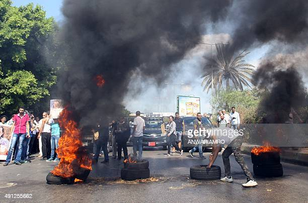 Relatives of Lebanese soldiers and policemen being held hostage by jihadists burn tires in order to cut off the old airport road in Beiruts southern...
