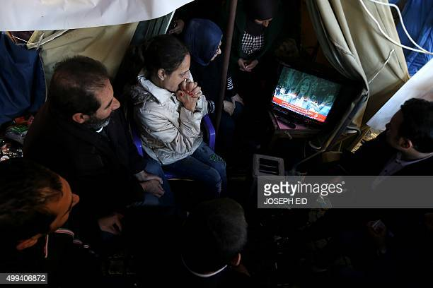 Relatives of Lebanese soldiers and policemen kidnapped by a jihadist group from the eastern border town of Arsal last year react as they watch news...
