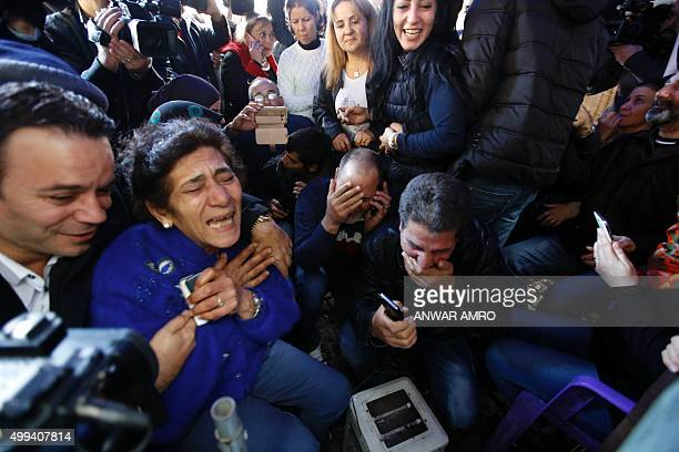 Relatives of Lebanese soldiers and policemen kidnapped by jihadist groups from the eastern border town of Arsal last year react following the release...