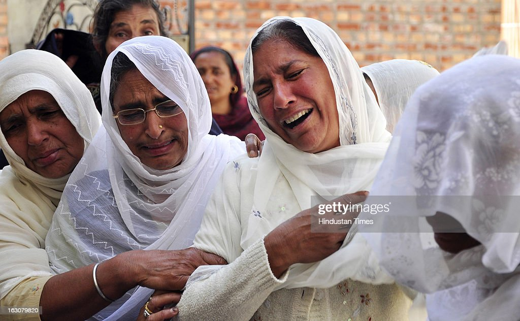 Relatives of Manpreet wailing who died after his school bus collided with a truck laden with bricks on March 4, 2013 in Jalandhar, India. Atleast Twelve children and their driver were reportedly killed in the accident near Jaheera village in Lambhra, close to Nakodar town in the morning.