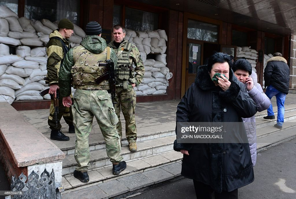 Relatives of miners leave the main entrance of the Zasyadko mine in Donetsk after the mine was rocked by an explosion on March 4 2015 At least 32...