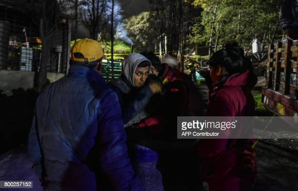 Relatives of miners missing in mine wait for news during search operations outside of 'La Guasca' mine in a rural area of Cucunuba Cundinamarca...