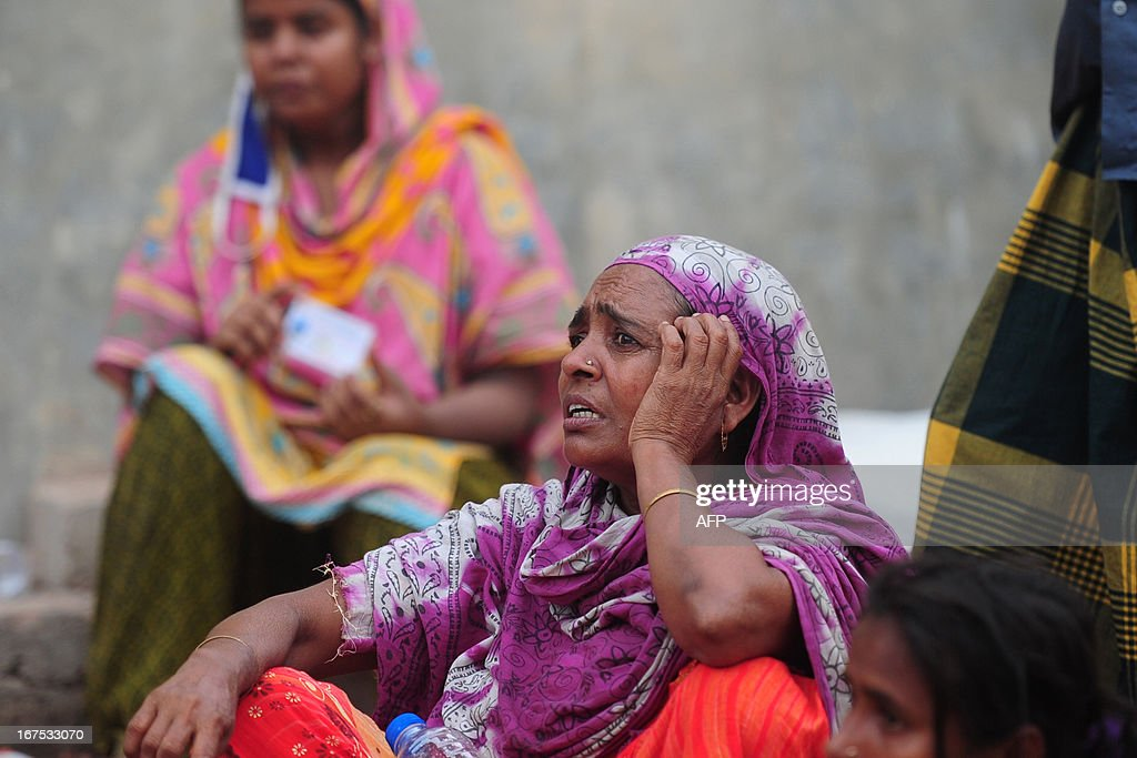 Relatives of missing garment factory workers wait as volunteers and rescue workers conduct rescue operations after an eight-storey building collapsed in Savar, on the outskirts of Dhaka, on April 26, 2013. A total of 304 people are so far known to have died after the eight-storey building collapsed in the town of Savar on April 24. Rescuers are racing against time to find more survivors in searing temperatures, watched on by hundreds of anxious relatives waiting for news of their missing loved ones.