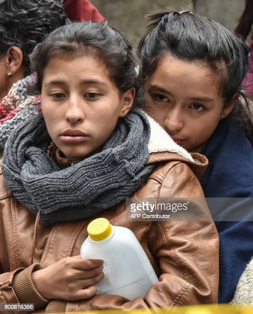 Relatives of missing miners wait during search operations after an explosion at the El Cerezo illegal coal mine killed at least eight people in the...