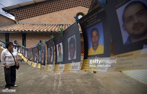 Relatives of missing people look at silhouettes bearing their names at 'La Escombrera' a dumping ground for construction materials at the Commune 13...