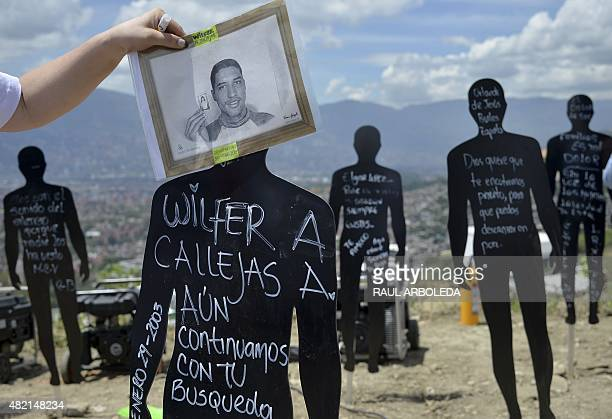 Relatives of missing people participate in a ceremony at 'La Escombrera' rubbish dump in the 13 Commune shantytown in Medellin Antioquia department...