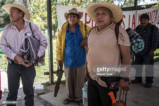 Relatives of missing students from Ayotzinapa load their belongings and machetes as they get ready to leave the Raul Isidro Burgos of Ayotzinapa...