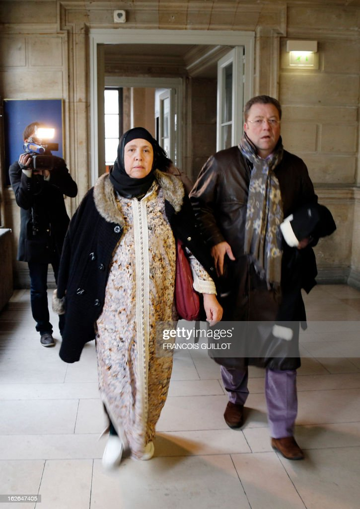 Relatives of Mohammed Legouad, one of the victims of Islamist gunman Mohamed Merah in March 2012, arrive with their lawyer Olivier Morice (R) at Paris courthouse on February 25, 2013 before meeting the investigating anti-terror judges.